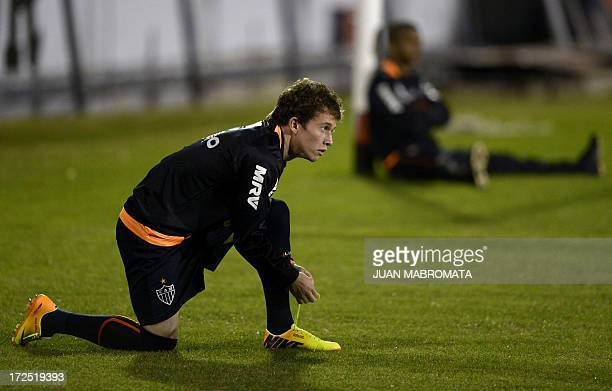 Brazil's Atletico Mineiro midfielder Bernard ties his boot during a training session at Marcelo Bielsa stadium in Rosario some 350 km north of Buenos...