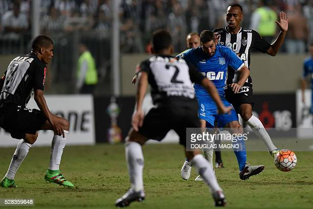 Brazil's Atletico Mineiro player Eduardo vies for the ball with Argentina's Racing player Lisandro Lopez during their 2016 Libertadores Cup football...