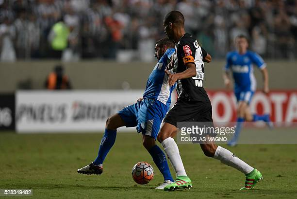Brazil's Atletico Mineiro player Leonardo Silva vies for the ball with Argentina's Racing player Lisandro Lopez during their 2016 Libertadores Cup...