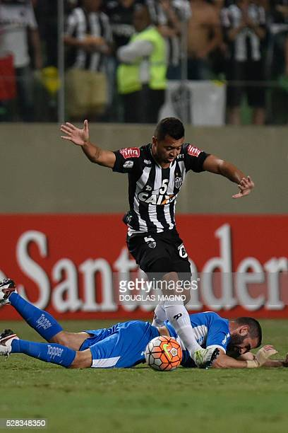 Brazil's Atletico Mineiro player Rafael Carioca vies for the ball with Argentina's Racing player Lisandro Lopez during their 2016 Libertadores Cup...