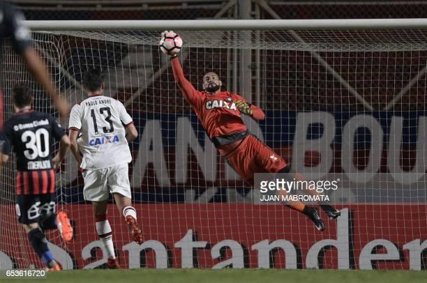 Brazil's Atletico Paranaense goalkeeper Weverton stops the ball during their Copa Libertadores 2017 group 4 football match against Argentina's San...