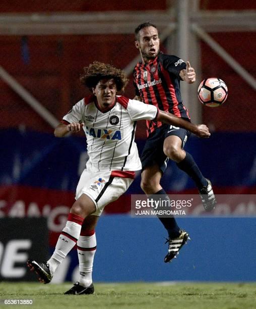 Brazil's Atletico Paranaense midfielder Felipe Gedoz vies for the ball with Argentina's San Lorenzo midfielder Fernando Belluschi during their Copa...
