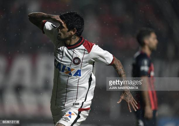 Brazil's Atletico Paranaense midfielder Lucho Gonzalez celebrates after scoring a goal against Argentina's San Lorenzo during their Copa Libertadores...