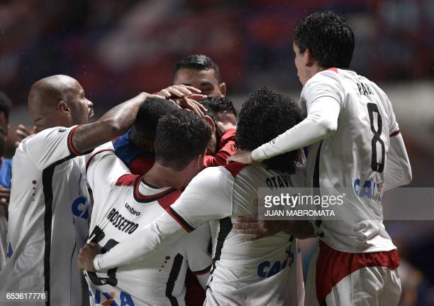 Brazil's Atletico Paranaense midfielder Lucho Gonzalez celebrates with teammates after scoring against Argentina's San Lorenzo during their Copa...
