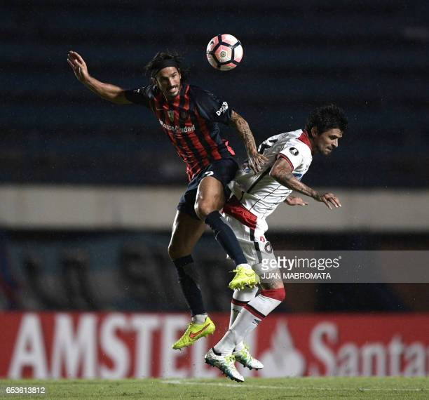 Brazil's Atletico Paranaense midfielder Lucho Gonzalez vies for the ball with Argentina's San Lorenzo defender Marcos Angeleri during their Copa...
