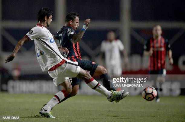 Brazil's Atletico Paranaense midfielder Lucho Gonzalez vies for the ball with Argentina's San Lorenzo midfielder Franco Mussis during their Copa...