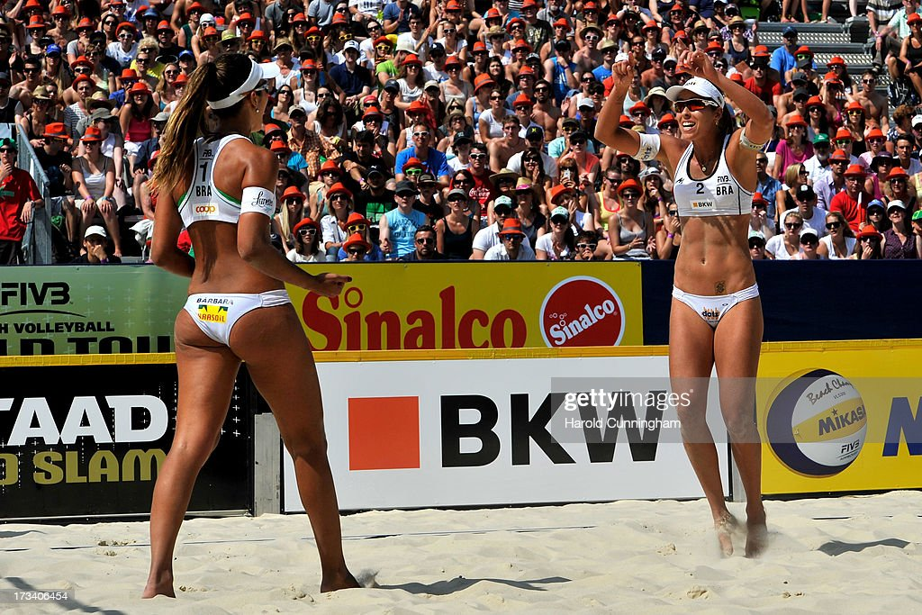 Brazil's Barbara Seixas and Liliane Maestrini celebrate their victory after the Lili-Seixas BRA v Ludwig-Walkenhorst semi-finals match as part of the FIVB Gstaad Grand Slam fifth day on July 13, 2013 in Gstaad, Switzerland.