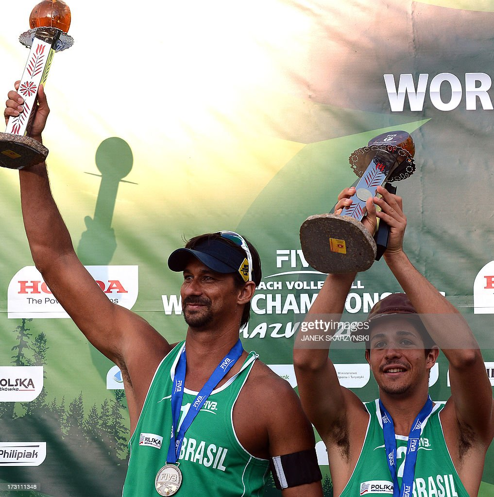 Brazil's beach volleyball player Ricardo Alex Costa Santos (L) and Alvaro Morais Filho (R) cheer as they won the silver medal during the Beach Volleyball World Championships on July 7, 2013 in Stare Jablonki, Poland.