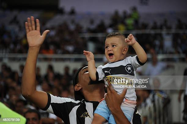 Brazil's Botafogo fans cheer their team before the start of their Libertadores football match against Chile's Union Espanola at the Mario Filho...