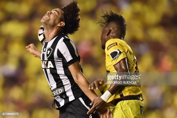 Brazil's Botafogo player Camilo vies for the ball with Ecuador's Barcelona player Dario Aimar during their 2017 Copa Libertadores football match at...