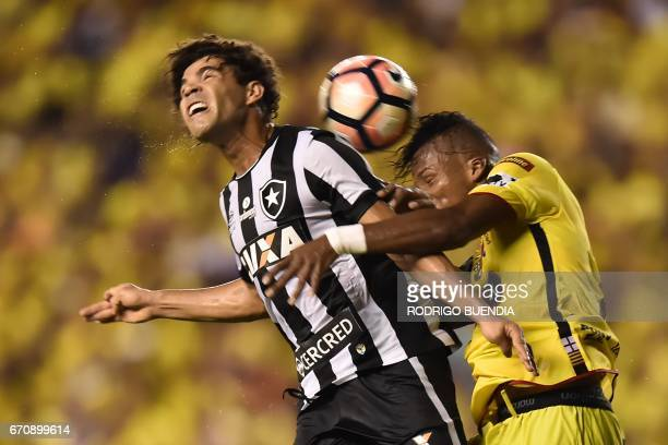 Brazil's Botafogo player Camilo vies for the ball with Ecuador's Barcelona player Dario Aimar during their 2017 Copa Libertadores football match at...