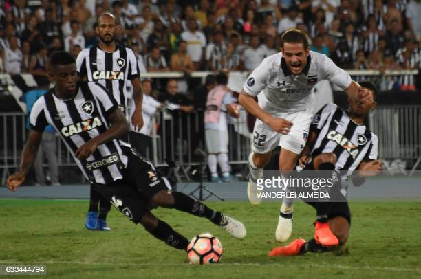 Brazil's Botafogo player Marcelo Conceicao vies for the ball with Chile's ColoColo player Raul Rivero during their Copa Libertadores football match...