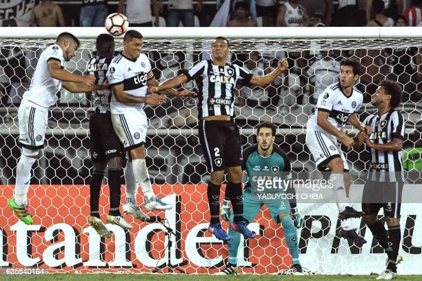 Brazil's Botafogo player Marcelo Conceicao vies for the ball with Paraguay's Olimpia Player Richard Ortiz during their Copa Libertadores 2017...