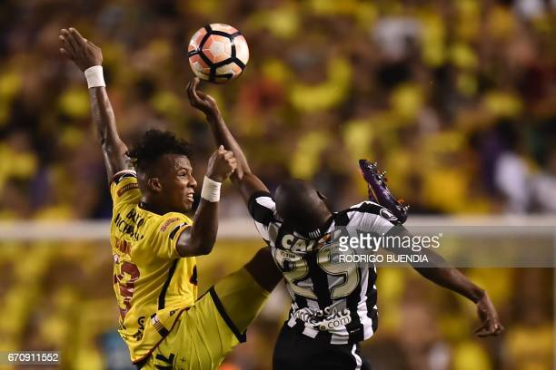 Brazil's Botafogo player Sassa vies for the ball with Barcelona's Dario Aimar during their 2017 Copa Libertadores football match at Monumental...