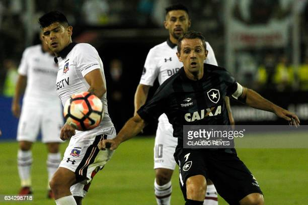 Brazil's Botafogo player Walter Montillo vies for the ball with Chile's ColoColo player Esteban Pavez during their Copa Libertadores football match...