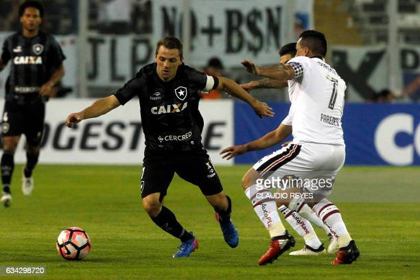 Brazil's Botafogo player Walter Montillo vies for the ball with Chile's ColoColo player Esteban Paredes during their Copa Libertadores football match...