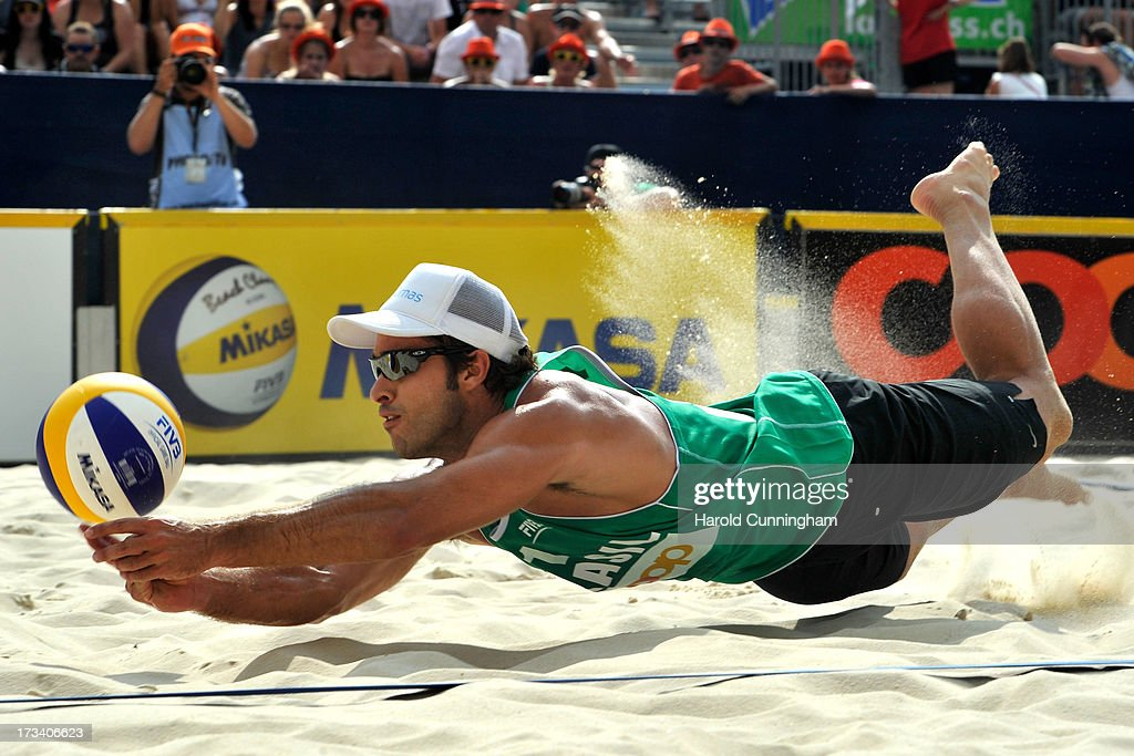 Brazil's Bruno Oscar Schmidt dives during the Gibb-Patterson v Pedro-Bruno semi-finals match as part of the FIVB Gstaad Grand Slam fifth day on July 13, 2013 in Gstaad, Switzerland.