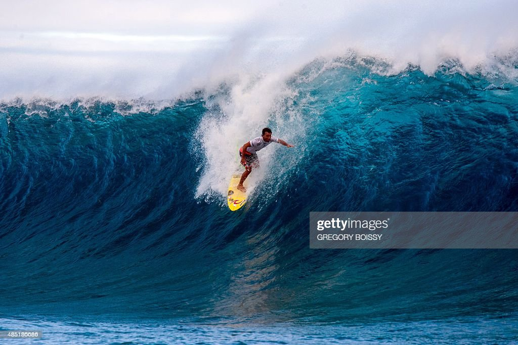 Brazil's Bruno Santos competes in the 2015 Billabong Pro Tahiti World Surf league tour n°4 along the Teahupo'o coast western of the French polynesia...