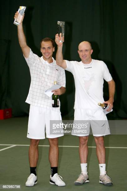 Brazil's Bruno Soares and Zimbabwe's Kevin Ullyett celebrate with their trophy's after beating Great Britain's Jamie Murray and South Africa's Jeff...