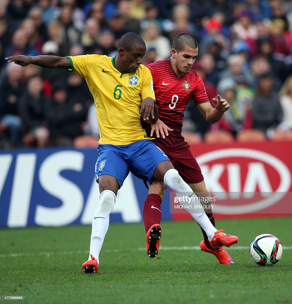 Brazil s Caju L fights for the ball with Portugal s Andre Silva