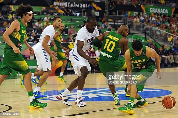 Brazil's center Anderson Varejao Brazil's guard Leandrinho Barbosa and Brazil's guard Raulzinho Togni Neto vies with France's forward Charles Kahudi...