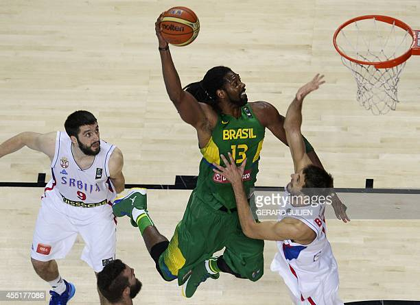 Brazil's centre Nene Hilario scores past Serbia's guard Stefan Markovic and Serbia's forward Stefan Bircevic during the 2014 FIBA World basketball...