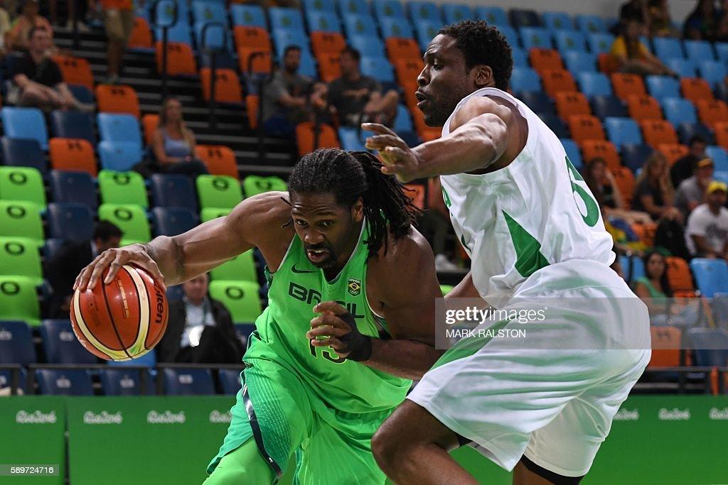 Brazil's centre Nene Hilario works around Nigeria's power forward Ike Diogu during a Men's round Group B basketball match between Nigeria and Brazil...