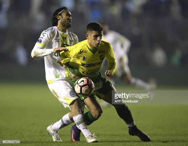 Brazil's Chapecoense defender Apodi vies for the ball with with Argentina's Defensa y Justicia defender Tomas Cardona during their Copa Sudamericana...