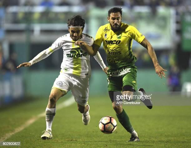 Brazil's Chapecoense defender Apodi vies for the ball with with Argentina's Defensa y Justicia midfielder Jonas Gutierrez during their Copa...