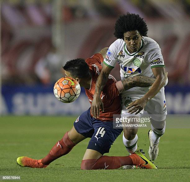 Brazil's Chapecoense defender Kempes vies for the ball with Argentina's Independiente defender Victor Cuesta during their Copa Sudamericana round...