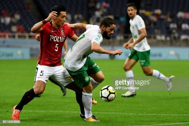 Brazil's Chapecoense FC forward Arthur Caike fights for the ball with Japan's Urawa Reds defender Tomoaki Makino during their soccer match in Saitama...