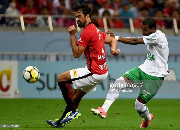 Brazil's Chapecoense FC midfielder Luiz Antonio fights for the ball with Japan's Urawa Reds forward Zlatan during their football friendly match in...