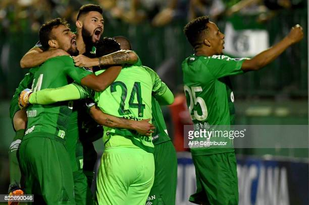 Brazil's Chapecoense footballers celebrate after defeating by penalty kicks against Argentina's Defensa y Justicia their 2017 Copa Sudamericana...