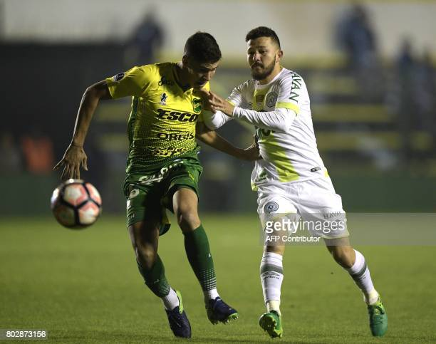 Brazil's Chapecoense forward Rossi vies for the ball with Argentina's Defensa y Justicia defender Tomas Cardona during their Copa Sudamericana second...
