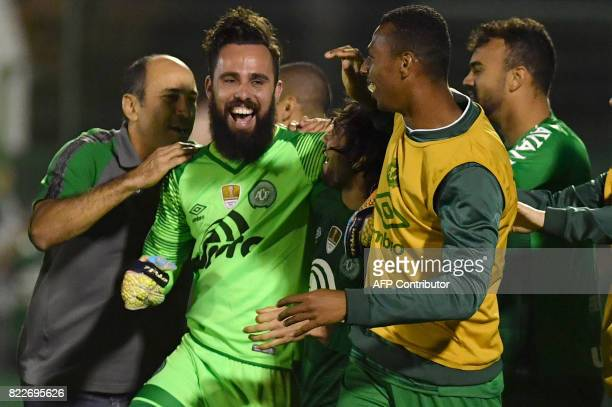 Brazil's Chapecoense goalkeeper Jandrei celebrates with teammates after defeating by penalty kicks Argentina's Defensa y Justicia in their 2017 Copa...