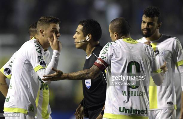 Brazil's Chapecoense midfielder Andrei Girotto argues with Peruvian referee Diego Haro after being sent off during the Copa Sudamericana second round...