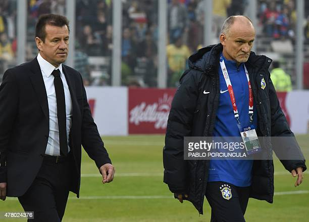 Brazil's coach Dunga and his assistant former Brazil's goalkeeper Claudio Taffarel are seen during their 2015 Copa America football championship...