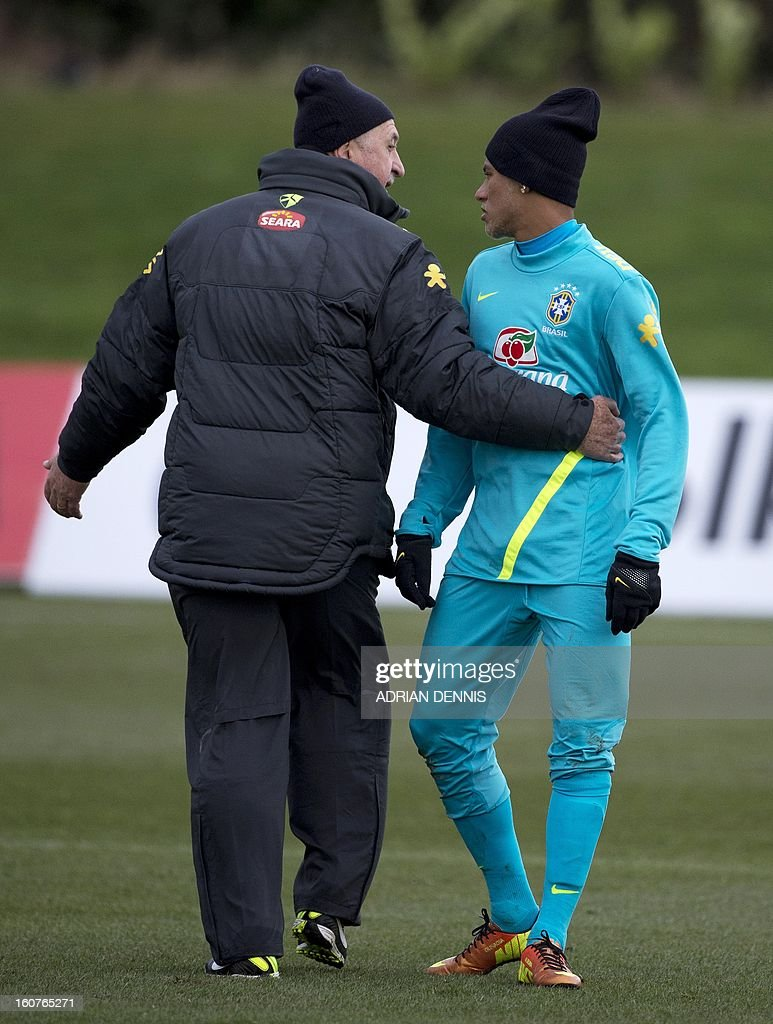 Brazil's Coach Felipe Scolari (L) talks with Neymar (R) during a training session at The Hive, Barnet FC's training ground in Edgware, London on February 5, 2013. Brazil are set to play England in an international friendly at London's Wembley Stadium on February 6, 2013 . Ronaldinho admits he did not expect to be recalled by Brazil, but says he believes the squad he has returned to possesses sufficient quality to win the 2014 World Cup on home soil. After a year in the international wilderness, the 32-year-old forward is expected to feature in Brazil's friendly game against England at Wembley.