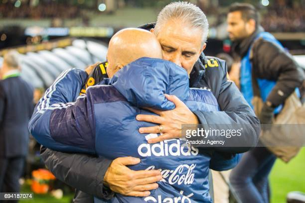 Brazil's Coach Tite and Argentina's Coach Jorge Sampaoli hug each other before the start of their clash during a friendly football international...