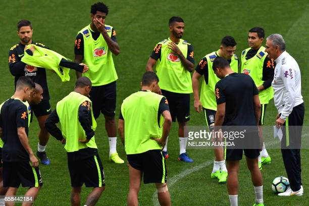 Brazil's coach Tite gives instructions to his players during a training session on the eve of their 2018 FIFA Russia World Cup qualifier football...