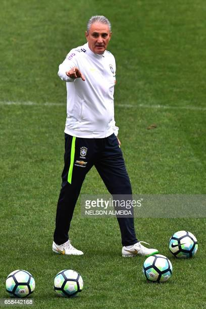 Brazil's coach Tite is seen during a training session on the eve of their 2018 FIFA Russia World Cup qualifier football match against Paraguay at the...