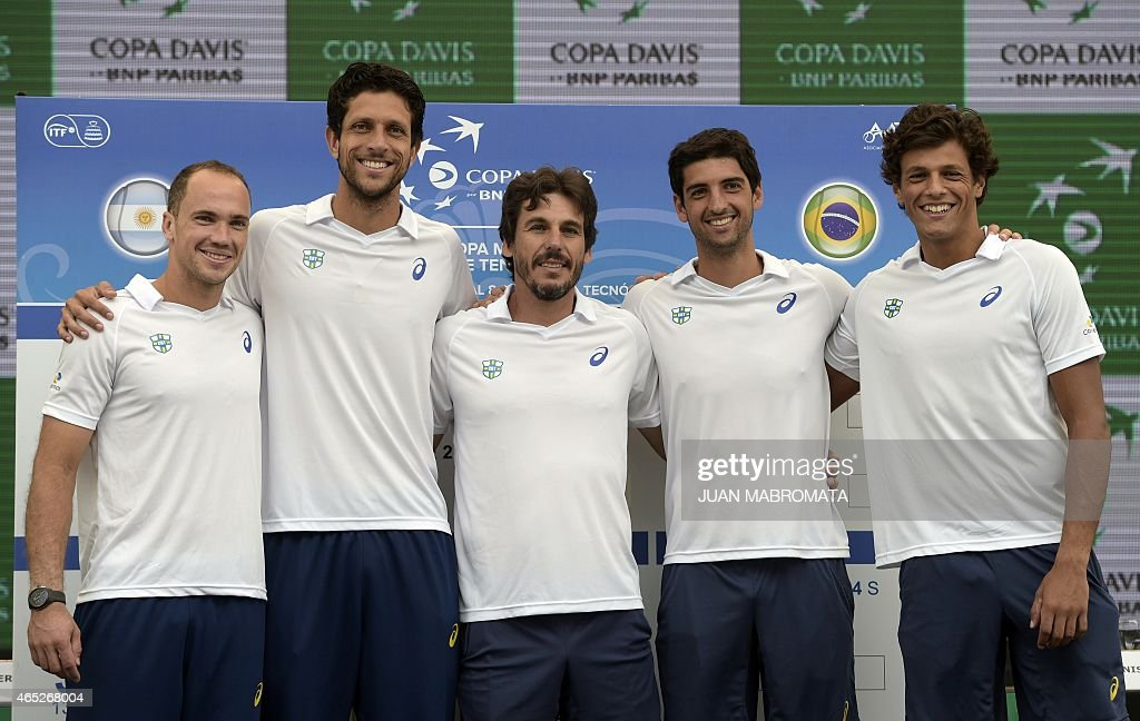 Brazil's Copa Davis tennis team (L-R) players <a gi-track='captionPersonalityLinkClicked' href=/galleries/search?phrase=Bruno+Soares+-+Tennis+Player&family=editorial&specificpeople=11650044 ng-click='$event.stopPropagation()'>Bruno Soares</a>, <a gi-track='captionPersonalityLinkClicked' href=/galleries/search?phrase=Marcelo+Melo&family=editorial&specificpeople=4278628 ng-click='$event.stopPropagation()'>Marcelo Melo</a>, tennis captain Joao Zwetsch, <a gi-track='captionPersonalityLinkClicked' href=/galleries/search?phrase=Thomaz+Bellucci&family=editorial&specificpeople=2984084 ng-click='$event.stopPropagation()'>Thomaz Bellucci</a> and <a gi-track='captionPersonalityLinkClicked' href=/galleries/search?phrase=Joao+Souza+-+Brazilian+Tennis+Player&family=editorial&specificpeople=7935783 ng-click='$event.stopPropagation()'>Joao Souza</a> pose during the draw ahead of their Davis Cup World Group 1st Round double tennis match in Villa Martelli, Buenos Aires, Argentina on March 5, 2015.