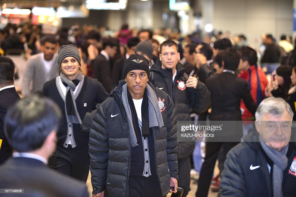 Brazil's Corinthians football player Paulinho (C) and his teammates arrive for the Club World Cup at Narita airport on December 6, 2012.