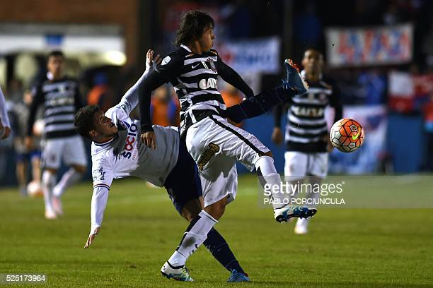 Brazil's Corinthians forward Angel Romero vies for the ball with Uruguay's Nacional defender Luis Espino during their Libertadores Cup round before...