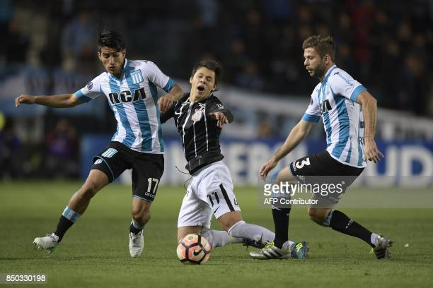 Brazil's Corinthians forward Angel Romero vies for the ball with Argentina's Racing Club defender Leandro Grimi and defender Alexis Soto during their...