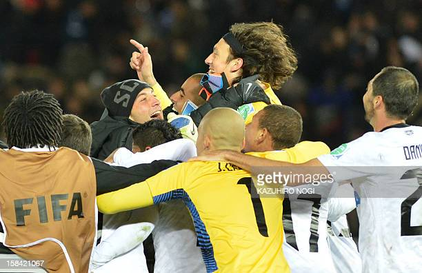 Brazil's Corinthians goalkeeper Cassio and his teammates celebrate their win over English Premier League team Chelsea at the end of the 2012 Club...