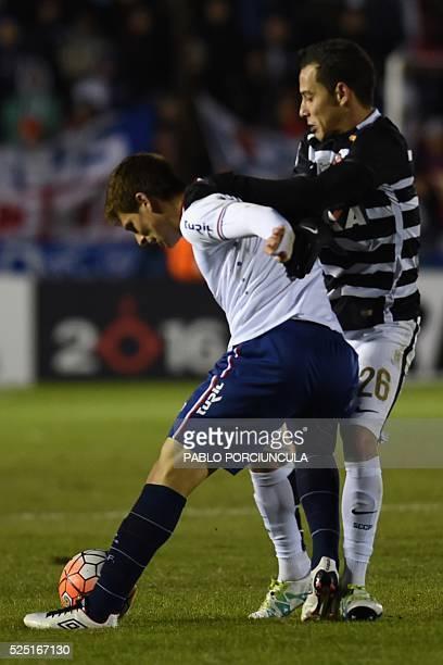 Brazil's Corinthians midfielder Rodriguinho vies for the ball with Uruguay's Nacional midfielder Santiago Romero during their Libertadores Cup round...