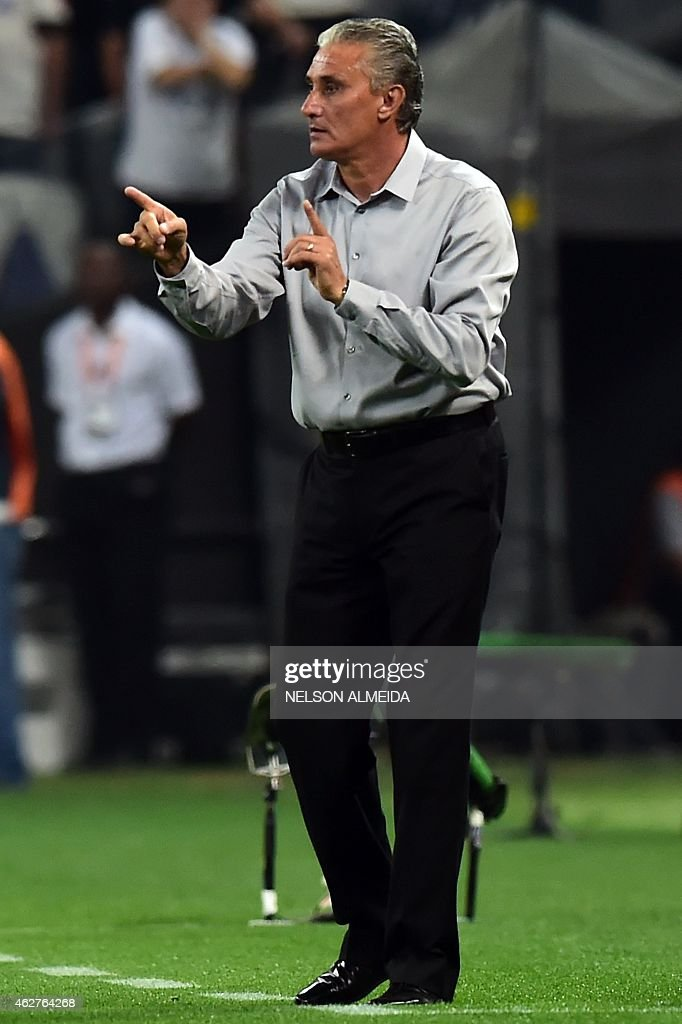 Brazils Corinthians team coach Tite gestures during the 2015 Copa Libertadores football match against Colombia's Once Caldas held at Arena Corinthians stadium, in Sao Paulo, Brazil, on February 4, 2015. AFP PHOTO / Nelson ALMEIDA