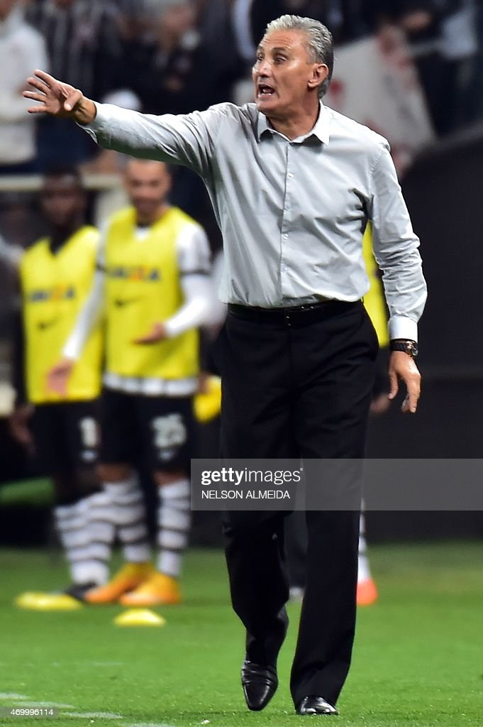 Brazils Corinthians team coach <a gi-track='captionPersonalityLinkClicked' href=/galleries/search?phrase=Tite+-+Entrenador+de+f%C3%BAtbol+brasile%C3%B1o&family=editorial&specificpeople=10072994 ng-click='$event.stopPropagation()'>Tite</a> gestures during their 2015 Copa Libertadores football match against Argentina's San Lorenzo held at Arena Corinthians stadium, in Sao Paulo, Brazil, on April 16, 2015. AFP PHOTO / Nelson ALMEIDA