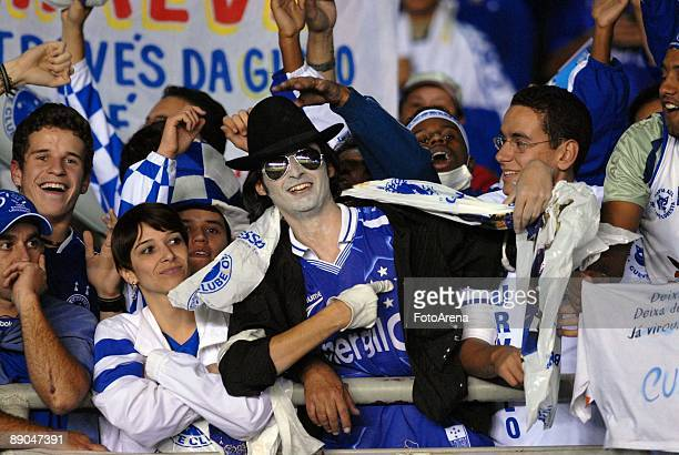 Brazil's Cruzeiro soccer fans and double of Michael Jackson cheer ahead of the Libertadores Cup 2009 final match against Argentina's Estudiantes at...